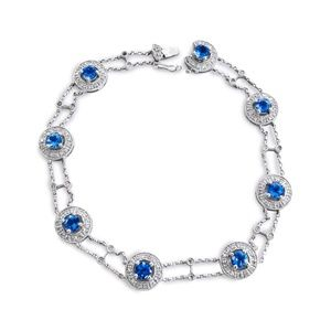 Jewelry - 14 Karat Diamond and Blue Topaz Ladies Bracelet